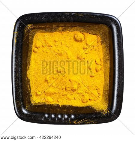 Top View Of Curcuma (turmeric) Powder In Black Bowl Isolated On White Background