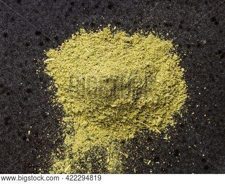 Top View Of Pile Of Milled Stevia Rebaudiana Herb (natural Sugar Substitute) Close Up On Black Ceram