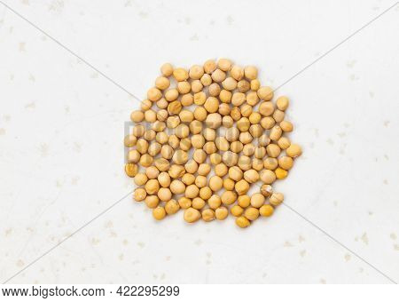 Several White Mustard Seeds (sinapis Alba) Close Up On Gray Ceramic Plate