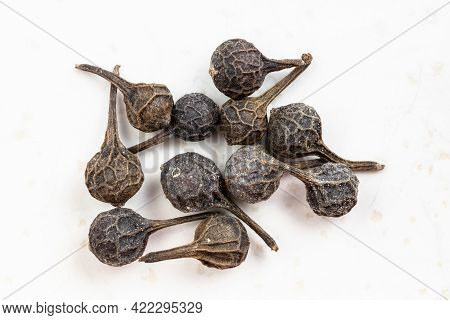 Several Tailed Pepper (cubeb) Close Up On Gray Ceramic Plate
