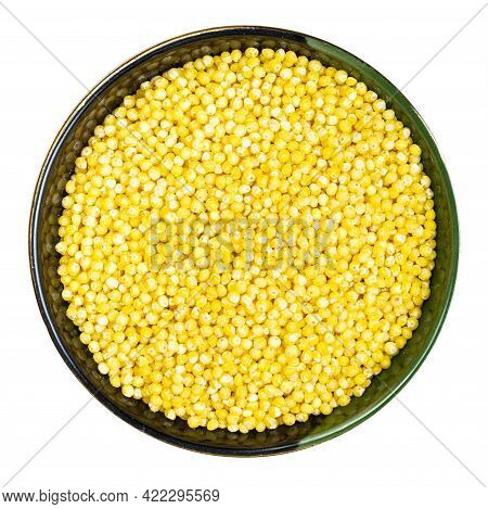 Top View Of Polished Proso Millet In Round Bowl Isolated On White Background