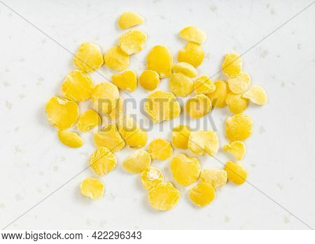 Several Raw Split Yellow Lentils Close Up On Gray Ceramic Plate