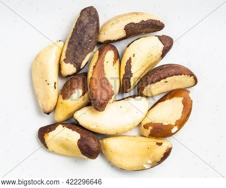 Top View Of Pile Of Raw Brazil Nuts Close Up On Gray Ceramic Plate