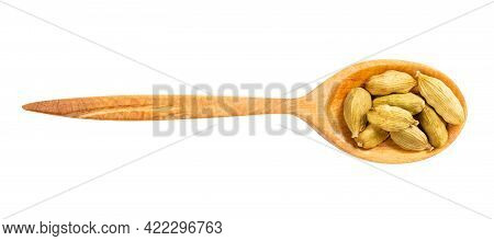 Top View Of Wood Spoon With Cardamom Seeds Isolated On White Background