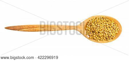 Top View Of Wood Spoon With Yellow Seeds Of Brassica Juncea Mustard Isolated On White Background