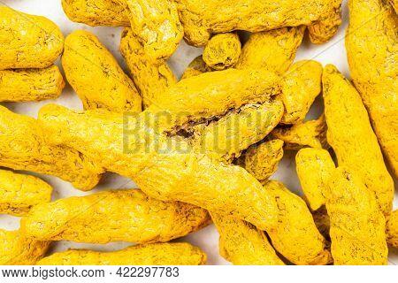 Food Background - Many Whole Turmeric (curcuma) Roots