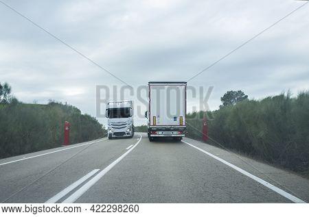Dense Trucks Traffic. Trucks In Both Lanes. Driving Scene