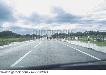 Driving Behind A Truck Under Persistent Drizzle. Bad-weather Driving Concept
