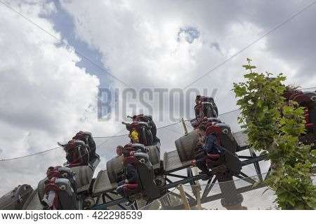 Salou, Spain, May 1, 2020 - Furious Baco Riders Over Port Aventura Amusement Park Against Cloudy Sky