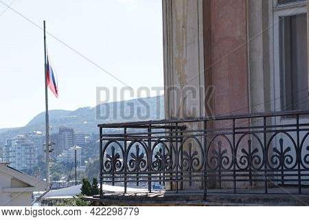 Russian Flag On The Background Of The City. Yalta, Crimea