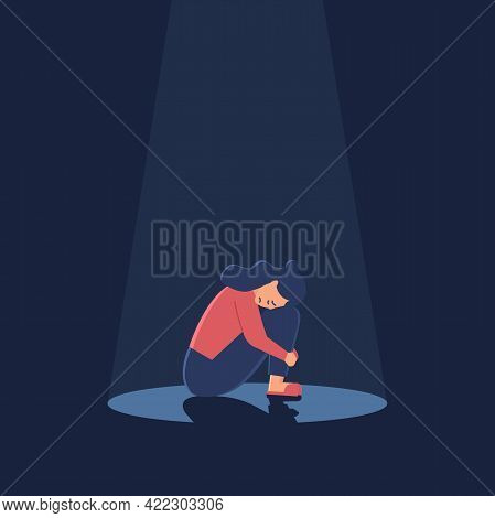 Sad Crying Lonely Young Woman Sitting On Floor In Spotlight. Depressed Unhappy Girl. Female Characte