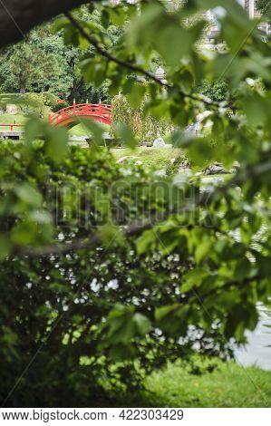 Japanese Garden Of Buenos Aires, Argentina. The Taiko Bashi, A Curved Red Bridge With The Traditiona