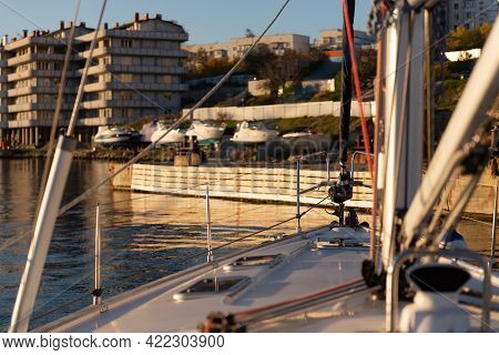 Photo From The Bow Of The Yacht Before Mooring. In The Evening Sun, The Yacht Is Moored. Photo From
