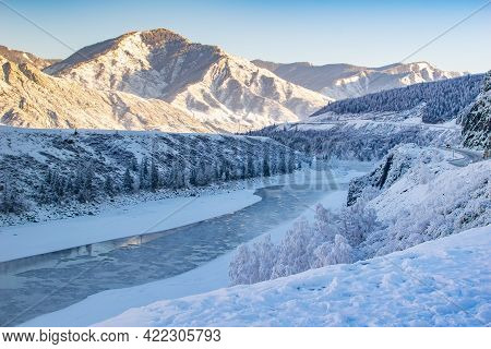 Winter, Frosty, Snowy Landscape Of The Valley With A River, High Mountain Peaks With Sharp Bare Ston