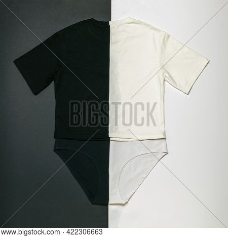 Black And White Set Of Shorts And T-shirt On A Black And White Background. Contrasting Set Of Summer