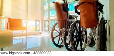 Empty Wheelchair In Private Hospital For Service Patient And Disabled People. Medical Equipment In H