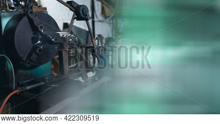 Composition of machinery in industrial workshop with copy space on green background. industry concept digitally generated image.