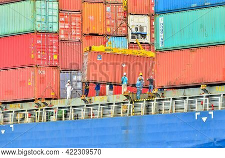 Labuan,malaysia-may 20,2021:big Containers Being Unloaded From A Huge Cargo Ship In The Labuan Ft,ma