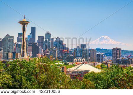 Seattle, Washington, USA downtown skyline with Mt. Rainier.