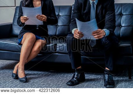 Stressed Businessman And Businesswoman Candidate Sit And Wait For Interview At The Company Office. J