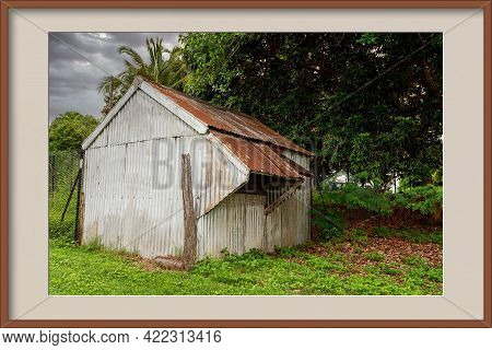 Old Corrugated Iron Shed With Push Out Windows In A Lush Green Garden, In A Photo Frame