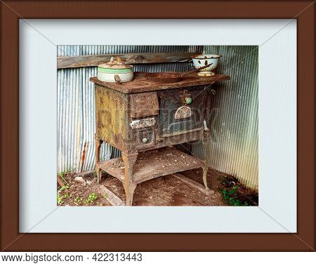 Historical Old Rusted Iron Stove From Yesteryear Left Outside To Further Corrode Away, Presented In