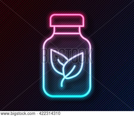 Glowing Neon Line Fertilizer Bottle Icon Isolated On Black Background. Vector