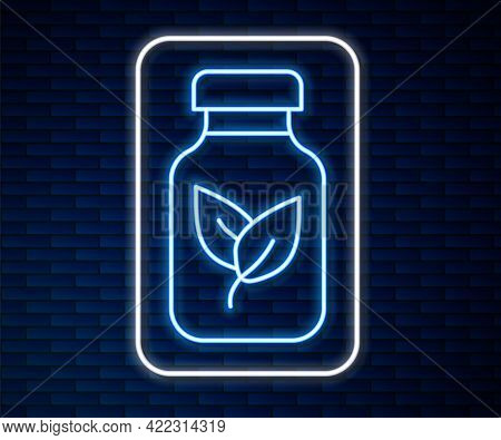 Glowing Neon Line Fertilizer Bottle Icon Isolated On Brick Wall Background. Vector