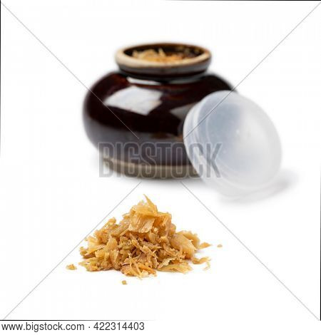 Heap of Chinese fermented cabbage, tung choi,  and ceramic bowl in the background isolated on white background