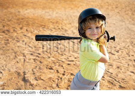 Boy In Baseball Helmet And Baseball Bat Ready To Bat.