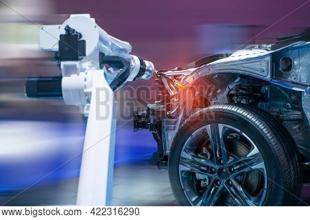 robotic welders arms weld the car part on factory on manufacture of the Assembly line