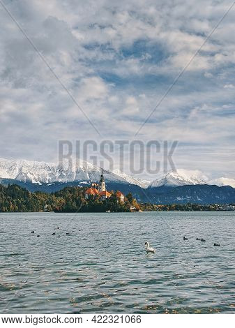 Scenic view of the snow-capped mountain peaks against the backdrop of lake Bled. Slovenia.