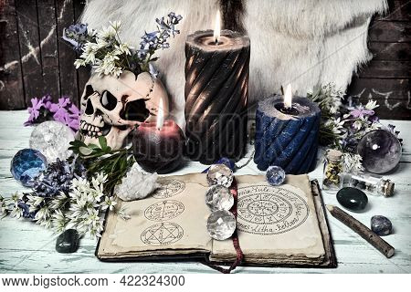Still Life With Open Book With Wiccan Holidays And Symbols, Crystal And Burning Candles. Esoteric, G