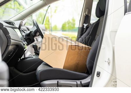 Parcels In Delivery Car. Driving With Parcels