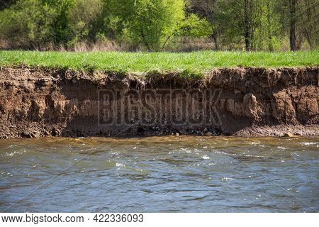A Vertical Riverbank With Steep Wall Of Dirt Suitable For Nesting Of Kingfisher
