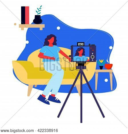 A Girl Blogger Records A Video Sitting At Home On The Couch, Recording A Video On The Camera, A Blog