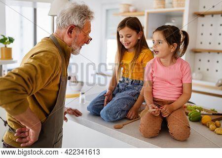 Grandfather Is Scolding His Grandchildrens Girls. Family, Punishment, Discipline Concept