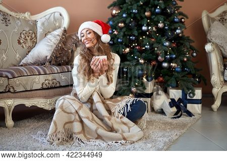 Christmas Woman Dressed White Sweater Santa Hat Sitting On Floor Near Christmas Tree Wrapped Herself
