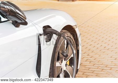 Charging An Electric Car At Hybrid Engine Gasoline And Electricity. Refueling For Cars E-mobility. C