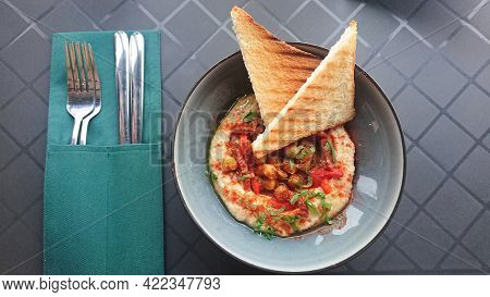 Homemade Spicy Hummus With Chickpeas, Red Sweet Pepper And Fresh Toasts
