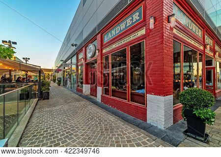 ASHDOD, ISRAEL - JULY 19, 2018: Exterior view of stylish Landwer coffee shop on cobblestone street in open air mall - owned by BIG Shopping Centers Ltd., founded in 1994, operates in four countries.