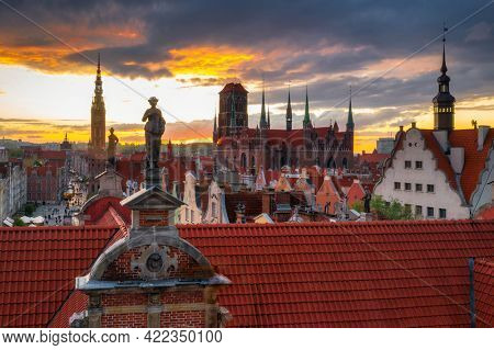 Amazing architecture of the main city in Gdansk at sunset, Poland. Aerial view of the Long Market, Main Town Hall and St. Mary Basilica