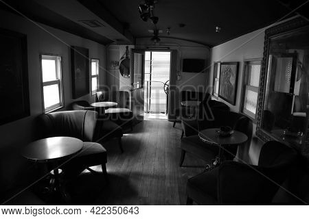 May 26, 2021 San Juan Capistrano, California: Inside an antique Train Rail Car showing the luxury of travel from the 1800's. Editorial. Black and White.