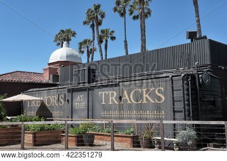 SAN JUAN CAPISTRANO, CALIFORNIA - 27 MAY 2021: Trevors at the Tracks Indoor-outdoor restaurant at an 1894 railway depot offering upscale New American food and drinks.