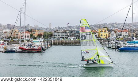San Francisco, California, Usa - September 28, 2019 : Two Sport Men Sailing Green Boat With Speed In