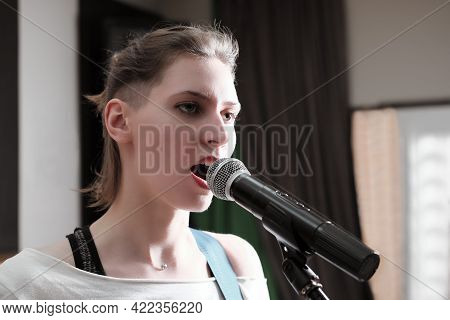 Young Passionate Woman Singing In A Microphone In A Studio. Vocal Audio Song Recording. Professional