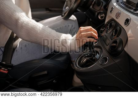 Woman Hand Shifting Gears On Gearbox In Automobile