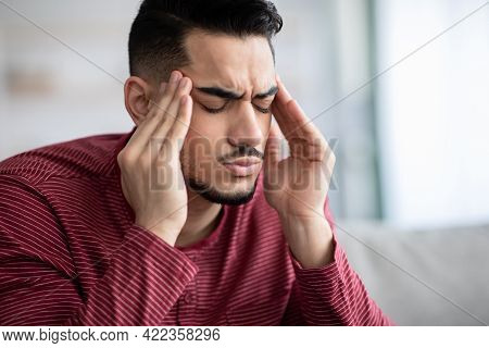 Upset Middle-eastern Guy Suffering From Headache, Closeup