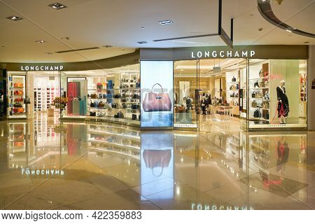 SINGAPORE - CIRCA JANUARY, 2020: Longchamp storefront in ION Orchard shopping mall in Singapore. Longchamp is a French luxury leather goods company.