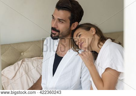 Lifestyle Family Or Honeymoon Concept. Enjoy Husband With His Wife Wearing Bathrobe Sitting Together